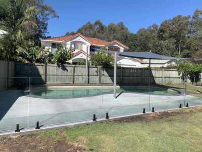 Five panel glass pool fence + black hardware