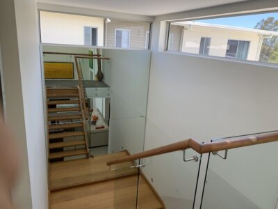 Four Mirror Install in Stairwell - Pelican Waters1